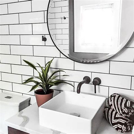Above Counter Porcelain Sink with Matte Black Finish Wall Mounted Faucet and Round Mirror