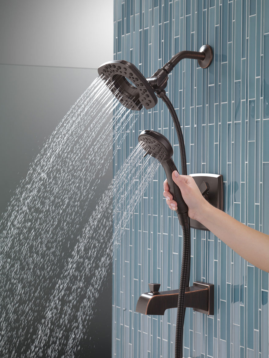 Delta Ashlyn Venetian Bronze In2ition Tub Shower Combination with Showerhead and Hand Shower Detached Both with Water