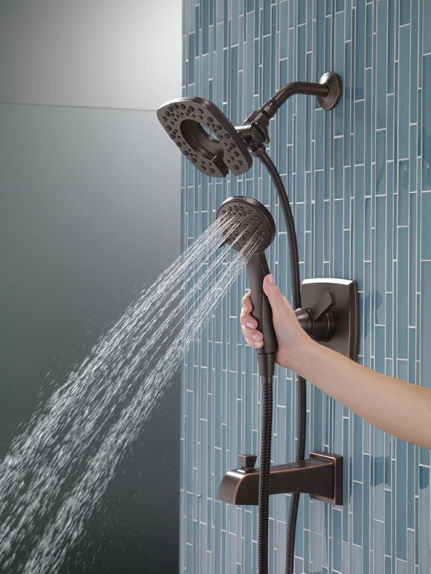 Delta Ashlyn Venetian Bronze In2ition Tub Shower Combination with Showerhead and Hand Shower Detached with Water