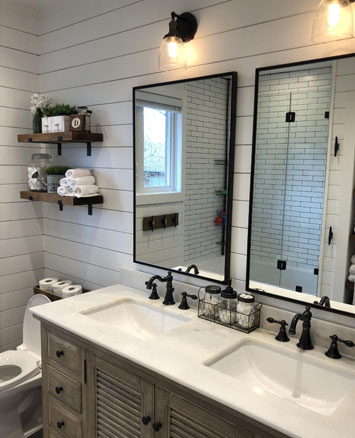 Double Sink Bathroom Vanity with Oil Rubbed Bronze Widespread Faucets Bronze Mirrors and Light Fixtures