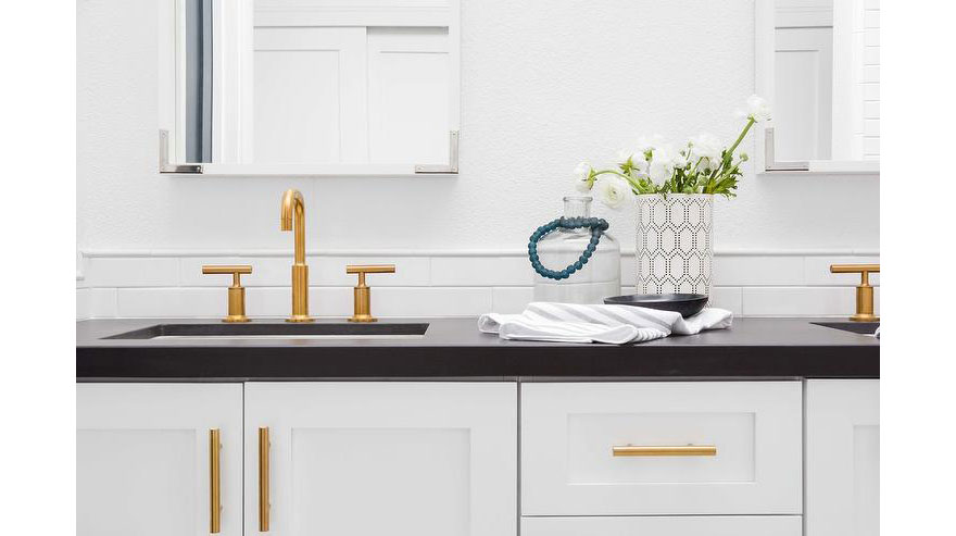 Gold Bathroom Sink Faucet with Black Countertop