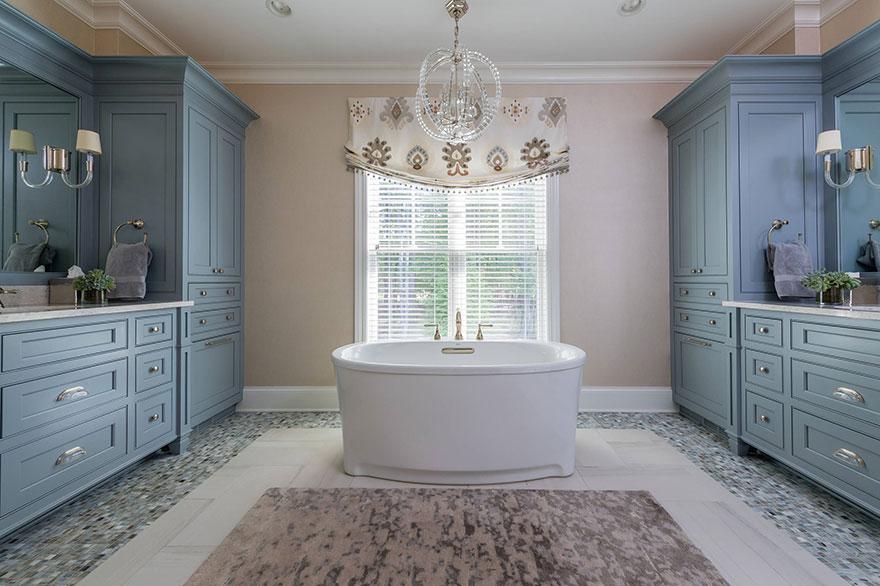 Elegant Master Bathroom with Bold Statement Lighting
