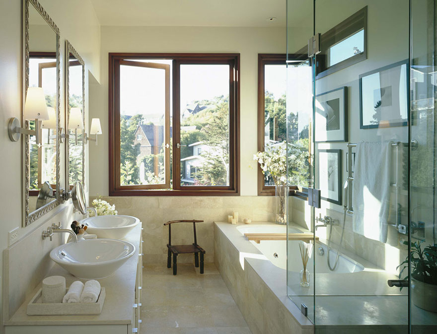 Master Bathroom with Natural Light, Bathtub, and Dual Vessel Sinks