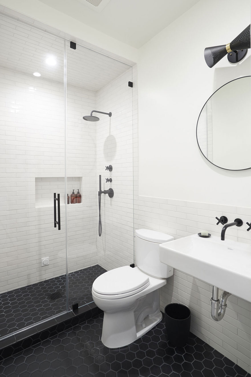 Small Bathroom Minimalist Design with Matte Black Shower System and Wall Mount Faucet