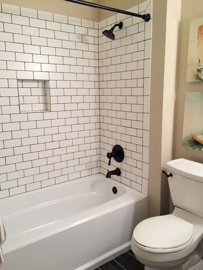 Oil Rubbed Bronze Tub and Shower Faucet with Bronze Shower Curtain Rod Tank Lever and White Subway Tiles