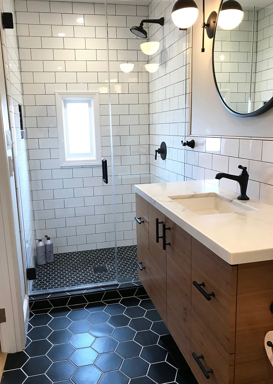 Small Bathroom with Black Shower Stall and Black Single Handle Faucet